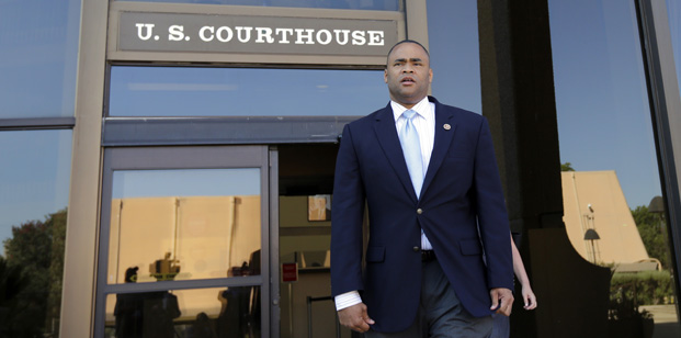 Rep. Marc Veasey, D-Texas, walks out of the U.S. Courthouse, Monday, July 14, 2014, in San Antonio. The U.S. Justice Department told judges in a trial that began Monday that Texas lawmakers carefully crafted electoral maps marginalizing minority voters despite the state's exploding Hispanic population in a deliberate effort to racially discriminate and protect conservative incumbents. (AP Photo/Eric Gay)